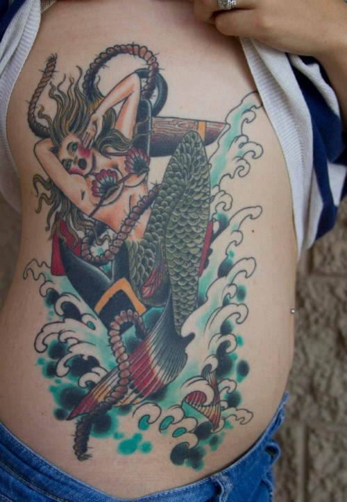 Mermaid rib tattoo