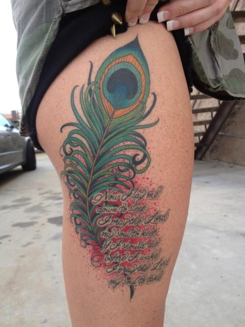 prayer feather thigh tattoo